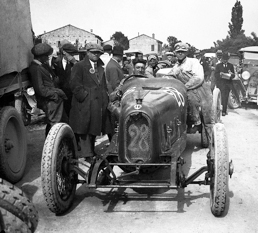 "Enzo Ferrari after winning the 1923 Circuito del Savio in an RLTF – the day he was presented with the ""Prancing Horse""."