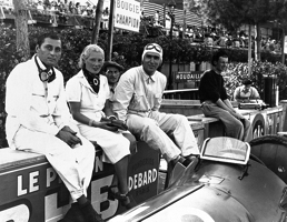 Successful Alfa private entrant Hans Ruesch sitting on the Monaco pit wall with a lady and Nino Farina.